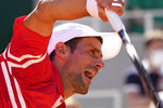 Serbia's Novak Djokovic serves the ball to Stefanos Tsitsipas of Greece during their final match of the French Open tennis tournament at the Roland Garros stadium Sunday, June 13, 2021 in Paris. (AP Photo/Michel Euler)