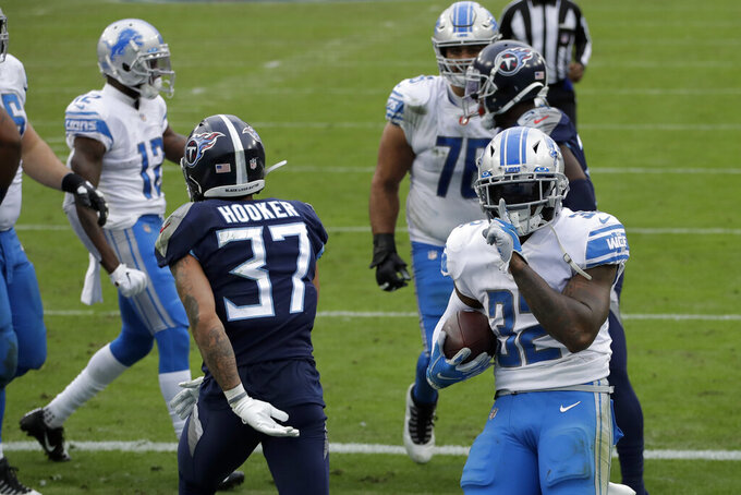 Detroit Lions running back D'Andre Swift celebrates after scoring against the Tennessee Titans during the first half of an NFL football game Sunday, Dec. 20, 2020, in Nashville, Tenn. (AP Photo/Ben Margot)