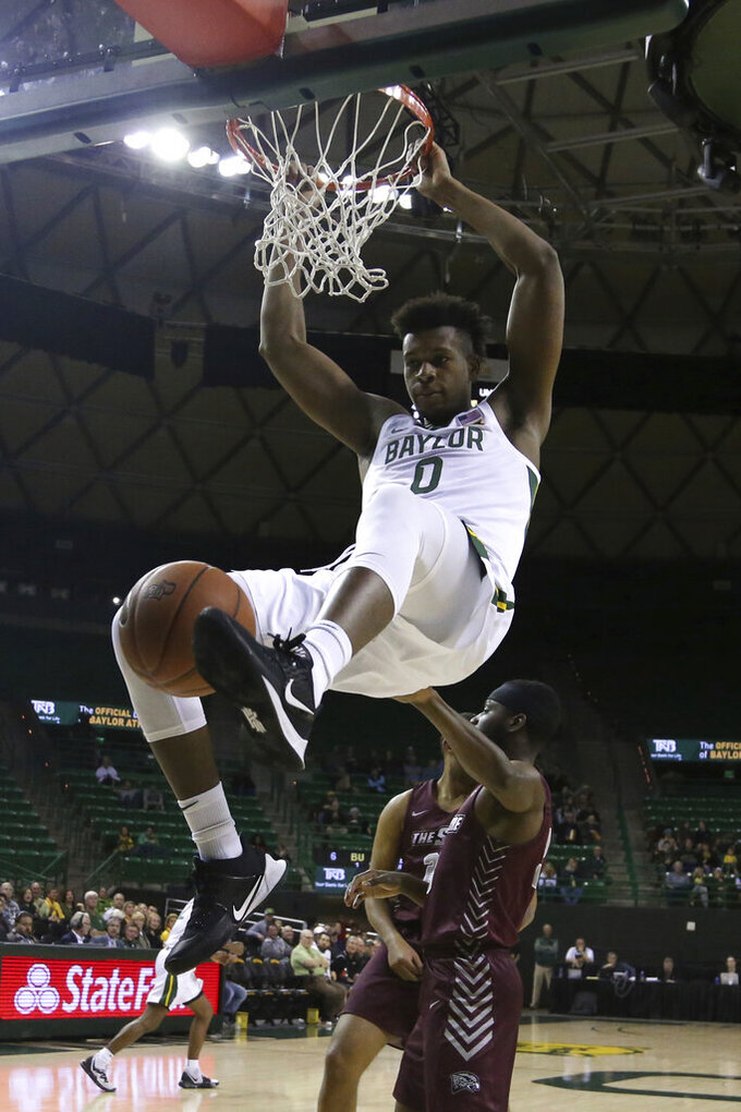Baylor forward Flo Thamba dunks over Maryland-Eastern Shore guard Canaan Bartley in the first half of an NCAA college basketball game,  Tuesday, Dec. 3, 2019, in Waco, Texas. (AP Photo/Rod Aydelotte)