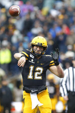 Appalachian State quarterback Zac Thomas (12) throws to an open receiver during the first half of an NCAA college football game against Texas State Saturday, Nov. 23, 2019, in Boone, N.C. (AP Photo/Brian Blanco)