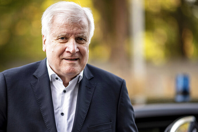FILE-In this Sept. 19, 2020 file photo Horst Seehofer, Federal Minister of the Interior, Building and Homeland Affairs, arrives at the Kongresshotel Potsdam, Germany. German prosecutors said Friday they won't open an investigation of a newspaper column that disparaged police and infuriated the country's interior minister, finding that it was covered by the right to freedom of expression. (Fabian Sommer/dpa via AP)