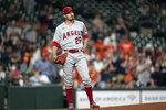 Los Angeles Angels starting pitcher Andrew Heaney (28) watches Houston Astros' Yuli Gurriel's two-run home run during the first inning of a baseball game Wednesday, May 12, 2021, in Houston. (AP Photo/David J. Phillip)