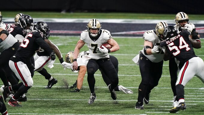 New Orleans Saints quarterback Taysom Hill (7) runs against the Atlanta Falcons during the second half of an NFL football game, Sunday, Dec. 6, 2020, in Atlanta. (AP Photo/Brynn Anderson)