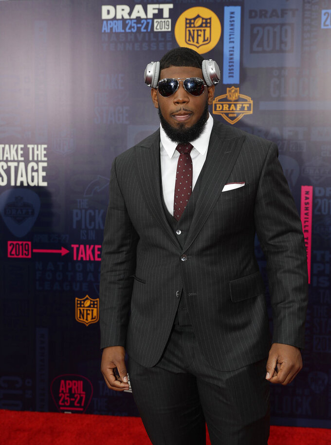 Houston defensive tackle Ed Oliver walks the red carpet ahead of the first round at the NFL football draft, Thursday, April 25, 2019, in Nashville, Tenn. (AP Photo/Mark Humphrey)