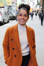 In this Tuesday, Feb. 18, 2020 photo, Ilda Mason poses outside the Broadway Theatre in New York, where she is making her Broadway debut in