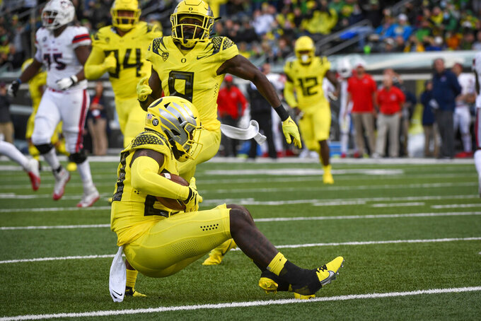 Oregon safety Verone McKinley III (23) makes and interception during the second quarter of an NCAA college football game against Stony Brook Saturday, Sept. 18, 2021, in Eugene, Ore. (AP Photo/Andy Nelson)