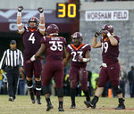 Virginia Tech defender Dax Hollifield (4) celebrates a defensive stop with his unit in the first half of an NCAA college football game against Miami in Blacksburg, Va., Saturday, Nov. 17 2018. (Matt Gentry/The Roanoke Times via AP)