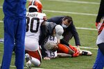 Cleveland Browns' Odell Beckham Jr. (13) is examined during the first half of an NFL football game against the Cincinnati Bengals, Sunday, Oct. 25, 2020, in Cincinnati. Browns star wide receiver Odell Beckham Jr. will miss the rest of the season after tearing a knee ligament during Sunday's 37-34 win at Cincinnati. (AP Photo/Michael Conroy)