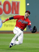 Cleveland Indians' Tyler Naquin catches a ball hit by Atlanta Braves' Dansby Swanson in the fourth inning of a baseball game, Sunday, April 21, 2019, in Cleveland. Swanson was out on the play. (AP Photo/Tony Dejak)