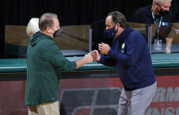 Michigan State coach Tom Izzo, left, and Notre Dame coach Mike Brey greet each other following an NCAA college basketball game Saturday, Nov. 28, 2020, in East Lansing, Mich. Michigan State won 80-70. (AP Photo/Al Goldis)