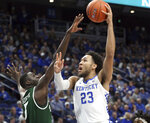 Kentucky's EJ Montgomery (23) shoots while defended by UAB's Makhtar Gueye during the first half of an NCAA college basketball game in Lexington, Ky., Friday, Nov. 29, 2019. (AP Photo/James Crisp)