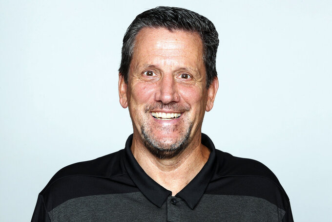 """FILE - This is a 2019 file photo shows Greg Knapp of the Atlanta Falcons NFL football team. Knapp, currently a New York Jets assistant coach was in a """"horrific"""" bicycle accident last weekend and is in critical condition. Denver TV station 9News reported Monday night, July 29, 2021, that Knapp was hit by a vehicle while riding in California. Agent Jeff Sperbeck confirmed to the station the 58-year-old longtime NFL assistant was hospitalized.  (AP Photo/File)"""