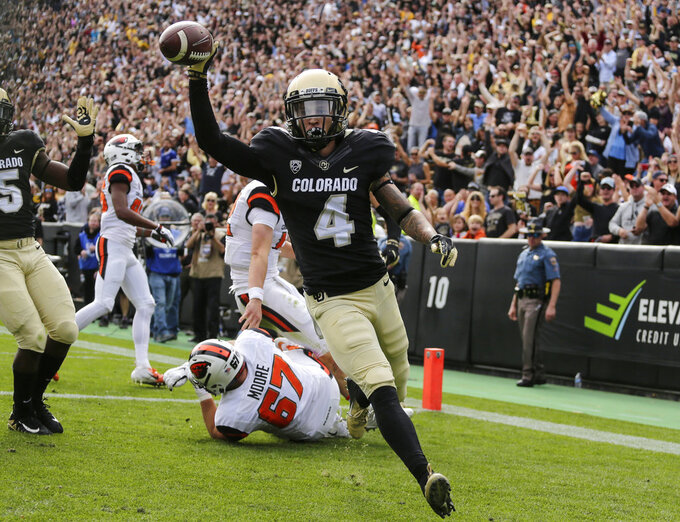 Colorado defensive back Dante Wigley (4) scores a touchdown after intercepting a pass against Oregon State during the first half of an NCAA college football game, Saturday, Oct. 27, 2018, in Boulder, Colo. (AP Photo/Jack Dempsey)