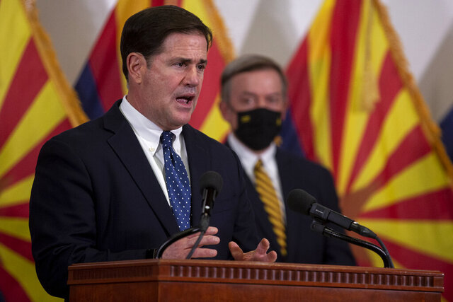 Arizona Gov. Doug Ducey speaks during a press conference regarding innovative COVID-19 solutions on Thursday, Sept. 24, 2020, at the Phoenix Biomedical Campus in Phoenix. (Sean Logan/The Arizona Republic via AP)