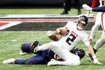 Atlanta Falcons quarterback Matt Ryan (2) is sacked by Denver Broncos defensive end Dre'Mont Jones (93) during the first half of an NFL football game, Sunday, Nov. 8, 2020, in Atlanta. (AP Photo/John Bazemore)