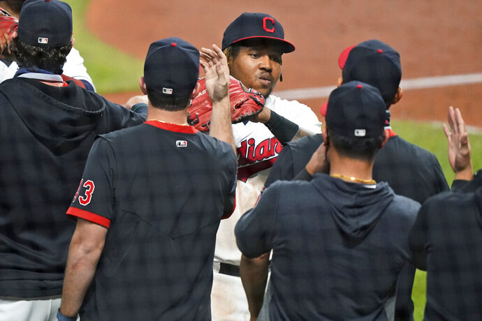 Cleveland Indians' Jose Ramirez is congratulated by teammates after the Indians defeated the Chicago White Sox 5-4 in a baseball game Thursday, Sept. 24, 2020, in Cleveland. (AP Photo/Tony Dejak)