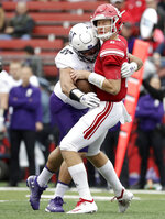 Northwestern defensive lineman Joe Gaziano, left, sacks Rutgers quarterback Artur Sitkowski during the first half of an NCAA college football game, Saturday, Oct. 20, 2018, in Piscataway, N.J. (AP Photo/Julio Cortez)