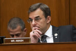 FILE - In this June 12, 2019 file photo, Rep. Justin Amash, R-Mich., listens to debate as the House Oversight and Reform Committee considers whether to hold Attorney General William Barr and Commerce Secretary Wilbur Ross in contempt for failing to turn over subpoenaed documents related to the Trump administration's decision to add a citizenship question to the 2020 census, on Capitol Hill in Washington. Amash, the only Republican in Congress to support the impeachment of President Donald Trump, said Thursday, July 3 he is leaving the GOP because he has become disenchanted with partisan politics and