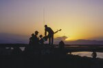 In this photo taken photo taken in September 1984, Soviet Army soldiers stand atop of a tank at a outpost during sunset in Afghanistan. When the Soviet Union completed its troops withdrawal from Afghanistan on Feb. 15 1989, it was widely hailed as a much-anticipated end to a bloody quagmire, but public perceptions have changed and many Russians now see the 10-year Soviet war in Afghanistan as a necessary and largely successful endeavor. (AP Photo/Alexander Zemlianichenko)