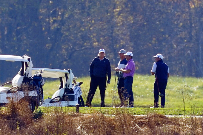 President Donald Trump participates in a round of golf at the Trump National Golf Course on Saturday, Nov. 7, 2020, in Sterling, Va. (AP Photo/Patrick Semansky)