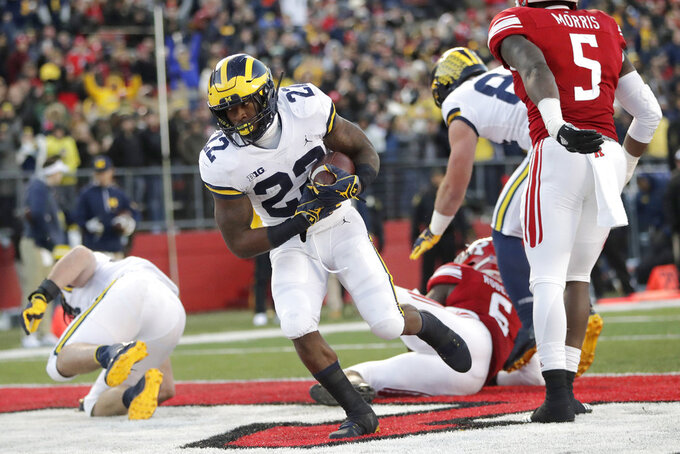 Michigan running back Karan Higdon (22) scores on a touchdown run against Rutgers during the first half of an NCAA college football game, Saturday, Nov. 10, 2018, in Piscataway, N.J. (AP Photo/Julio Cortez)
