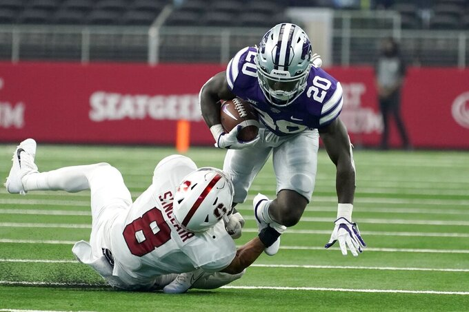 Stanford linebacker Tristan Sinclair (8) tackles Kansas State running back Joe Ervin (20) after a short gain in the second half of an NCAA college football game in Arlington, Texas, Saturday, Sept. 4, 2021. (AP Photo/Tony Gutierrez)