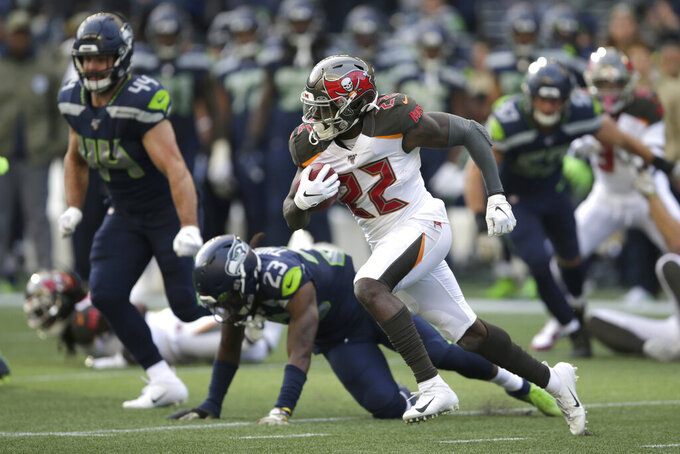 Tampa Bay Buccaneers running back T.J. Logan (22) rushes against the Seattle Seahawks during the first half of an NFL football game, Sunday, Nov. 3, 2019, in Seattle. (AP Photo/Scott Eklund)