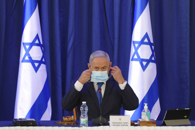 Israeli Prime Minister Benjamin Netanyahu wearing a face mask attends a government Cabinet meeting at the Ministry of Foreign Affairs in Jerusalem, Israel, Sunday, June 21, 2020. (Abir Sultan/Pool Photo via AP)