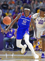 FILE - In this Nov. 16, 2018, file photo, then-Louisiana Tech forward Anthony Duruji (10) chases down the ball he just knocked loose from LSU forward Darius Days (22) in the first half of an NCAA college basketball game in Baton Rouge, La. Unlike a year ago, Florida begins the season unranked and won't have nearly as much hype even though they return seven of their top nine scorers and add four transfers, including Anthony Duruji. (AP Photo/Bill Feig, File)