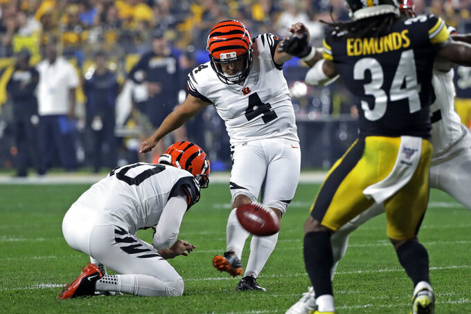 Cincinnati Bengals kicker Randy Bullock (4) boots a field goal during the first half of an NFL football game against the Pittsburgh Steelers in Pittsburgh, Monday, Sept. 30, 2019. (AP Photo/Don Wright)