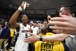 Connecticut's Isaiah Whaley celebrates with fans at the end an NCAA college basketball game against Houston, Thursday, March 5, 2020, in Storrs, Conn. (AP Photo/Jessica Hill)