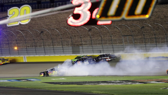 William Byron slides onto the infield grass during a NASCAR Cup Series auto race Sunday, Sept. 27, 2020, in Las Vegas. (AP Photo/Isaac Brekken)