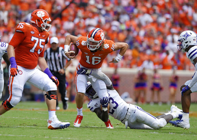 Clemson quarterback Dillon Vann (16) is tackled by Furman's Elijah McKoy, while Mitch Hyatt (75) looks to block during the first half of an NCAA college football game Saturday, Sept. 1, 2018, in Clemson, S.C. (AP Photo/Richard Shiro)