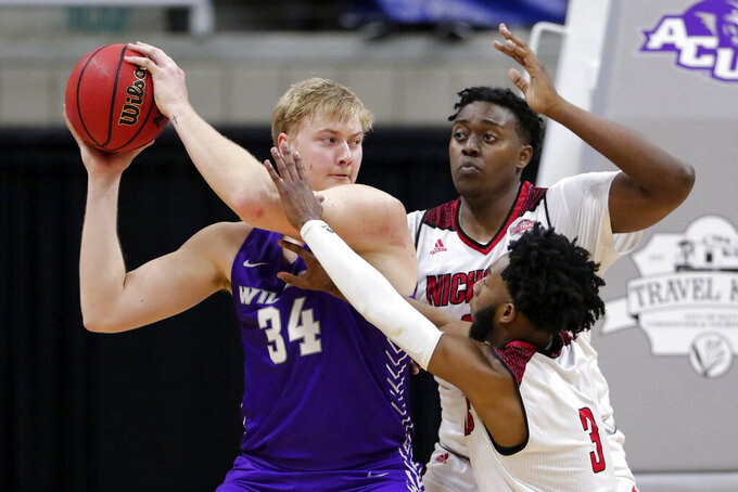 Abilene Christian center Kolton Kohl (34) looks to pass the ball under pressure from Nicholls State center Ryghe Lyons, middle, and guard Kevin Johnson (3) during the second half of an NCAA college basketball game for the Southland Conference men's tournament championship Saturday, March 13, 2021, in Katy, Texas. (AP Photo/Michael Wyke)