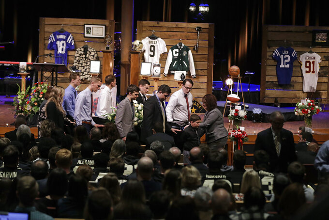 The casket carrying Tyler Trent is wheeled out following a funeral service for Trent at College Park Church, Tuesday, Jan. 8, 2019, in Indianapolis. Trent, an avid Purdue fan, died on New Year's Day following a bout with bone cancer. (AP Photo/Darron Cummings, Pool)