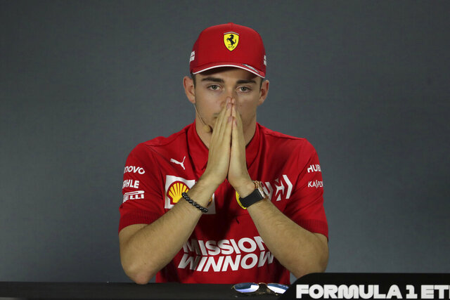 Ferrari driver Charles Leclerc of Monaco attends a news conference at the Yas Marina racetrack in Abu Dhabi, United Arab Emirates, Thursday, Nov. 28, 2019. The Emirates Formula One Grand Prix will take place on Sunday. (AP Photo/Hassan Ammar)