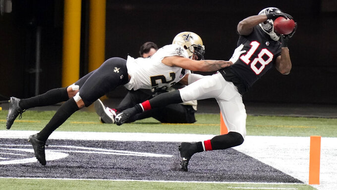 Atlanta Falcons wide receiver Calvin Ridley (18) misses the catch against New Orleans Saints safety Chauncey Gardner-Johnson (22) during the first half of an NFL football game, Sunday, Dec. 6, 2020, in Atlanta. (AP Photo/Brynn Anderson)