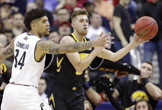 Iowa's Jordan Bohannon (3) passes against Cincinnati's Jarron Cumberland (34) in the second half during a first round men's college basketball game in the NCAA Tournament in Columbus, Ohio, Friday, March 22, 2019. Iowa won 79-72. (AP Photo/Tony Dejak)