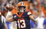 FILE - Syracuse's Tommy DeVito passes the ball during the first quarter of the team's NCAA college football game against Pittsburgh in Syracuse, N.Y., Friday, Oct. 18, 2019. DeVito has to improve in one facet of his game _ avoiding sacks. Syracuse allowed 4.17 sacks per game (50) to rank 128th out of 130 teams last season. Still, DeVito finished the year with a streak of 170 passes without an interception, the third-longest active streak in FBS heading into this season. (AP Photo/Nick Lisi, File)