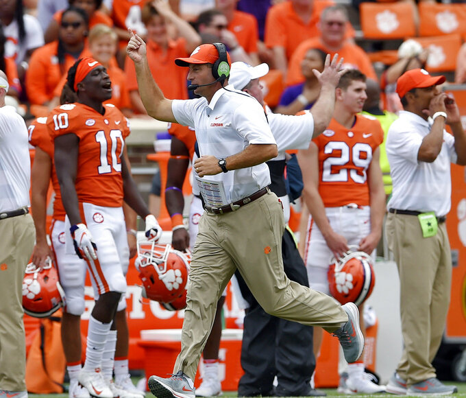 FILE - In this Sept. 15, 2018, file photo, Clemson head coach Dabo Swinney works the sideline during the second half of an NCAA college football game against Georgia Southern, in Clemson, S.C. Coach Dino Babers has led Syracuse to a surprising 4-2 record midway through the season, while Clemson and North Carolina State, led by quarterback Ryan Finley, are undefeated entering a big showdown this week. All drew attention in midseason voting by AP writers covering the 14 ACC teams. (AP Photo/Richard Shiro, File)