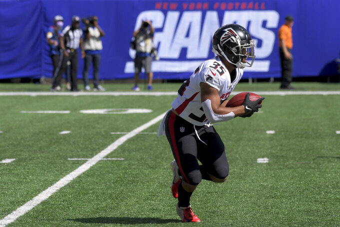 Atlanta Falcons cornerback Avery Williams runs the ball during the first half of an NFL football game against the New York Giants, Sunday, Sept. 26, 2021, in East Rutherford, N.J. (AP Photo/Bill Kostroun)