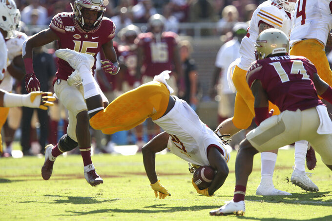 Louisiana-Monroe's Markis McCary goes head-over-heels as he is tackled on a kickoff return against Florida State in the first quarter of an NCAA college football game Saturday, Sept. 7, 2019, in Tallahassee Fla. (AP Photo/Steve Cannon)