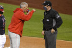 Philadelphia Phillies manager Joe Girardi, left, argues with home plate umpire Junior Valentine, right, after he was ejected during the third inning of a baseball game against the Washington Nationals, Monday, Sept. 21, 2020, in Washington. (AP Photo/Nick Wass)