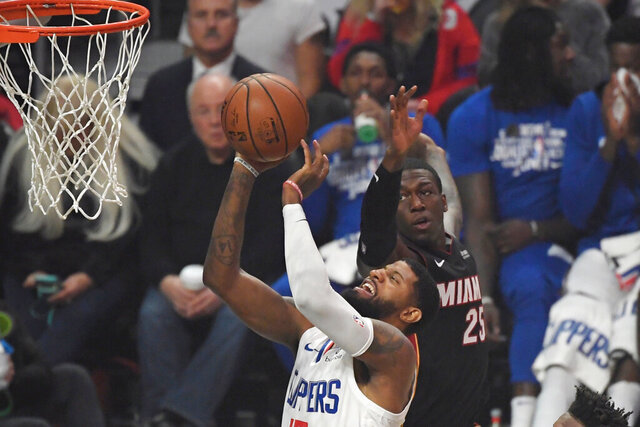Los Angeles Clippers guard Paul George shoots as Miami Heat guard Kendrick Nunn defends during the first half of an NBA basketball game Wednesday, Feb. 5, 2020, in Los Angeles. (AP Photo/Mark J. Terrill)