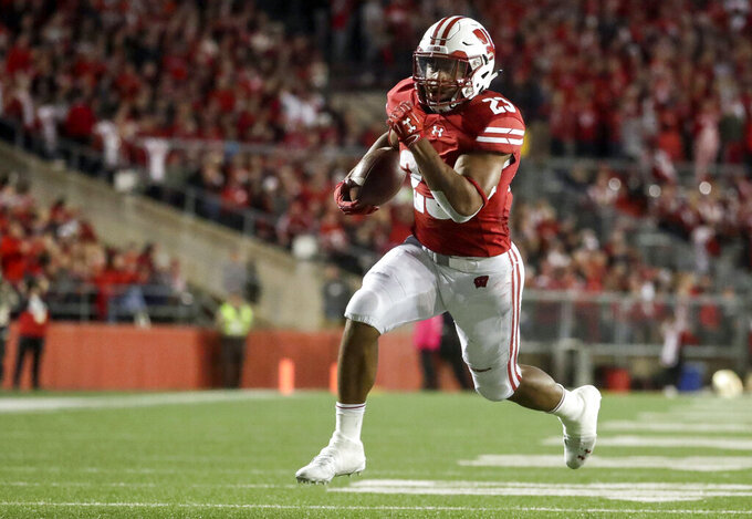 FILE - In this Oct. 6, 2018, file photo, Wisconsin's Jonathan Taylor runs for a touchdown during the second half of an NCAA college football game against Nebraska in Madison, Wis. Taylor led the nation in rushing last season, finishing with 2,194 yards and 16 touchdowns. No. 19 Wisconsin plays at South Florida on Friday, Aug. 31, 2019. (AP Photo/Morry Gash, File)