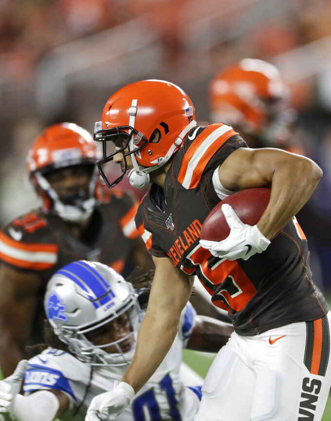 Cleveland Browns wide receiver Damon Sheehy-Guiseppi avoids a tackle during the second half of the team's NFL preseason football game against the Detroit Lions, Thursday, Aug. 29, 2019, in Cleveland. (AP Photo/Ron Schwane)