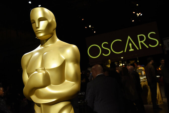 FILE - In this Friday, Feb. 15, 2019, file photo, an Oscar statue is pictured at the press preview for the 91st Academy Awards Governors Ball in Los Angeles. Movies that debuted on a streaming service without a theatrical run will be eligible for the Oscars, but only this year. The Academy of Motion Pictures Arts and Sciences on Tuesday announced the change for the 93rd Academy Awards as a response to how the coronavirus pandemic has impacted the film industry. (Photo by Chris Pizzello/Invision/AP, File)