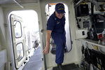 """U.S. Coast Guard Lt. Kelli Normoyle, Commanding Officer of the Coast Guard Cutter Sanibel, enters the bridge of the vessel, Thursday, Sept. 16, 2021, at a shipyard in North Kingstown, R.I. Normoyle was one of two cadets who formally started the process to create the CGA Spectrum Diversity Council just a few months after the law known as """"don't ask, don't tell"""" was repealed on Sept. 20, 2011. (AP Photo/Steven Senne)"""