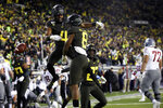 Oregon's Thomas Graham Jr., left, and Jevon Holland celebrate Holland's pick six against Washington State during the second quarter of an NCAA college football game Saturday, Oct. 26, 2019, in Eugene, Ore. (AP Photo/Chris Pietsch)