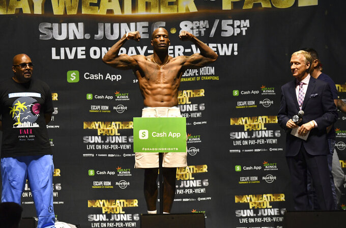 Chad Johnson poses for photographers during a weigh-in Saturday, June 5, 2021, in Hollywood, Fla. Johnson is scheduled to face Brian Maxwell in an exhibition boxing match at Hard Rock Stadium in Miami Gardens, Fla., Sunday. (AP Photo/Jim Rassol)